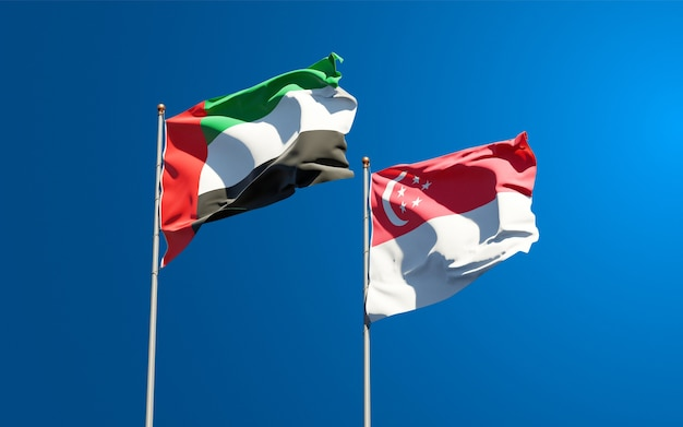 Beautiful national state flags of united arab emirates uae and singapore together