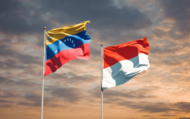 Beautiful national state flags of venezuela and indonesia together on blue sky