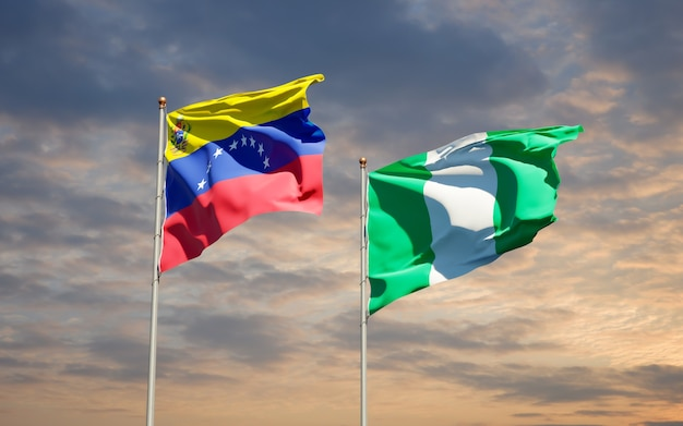 Beautiful national state flags of venezuela and nigeria together on blue sky