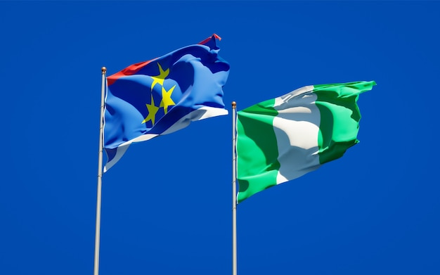 Beautiful national state flags of vojvodina and nigeria together on blue sky