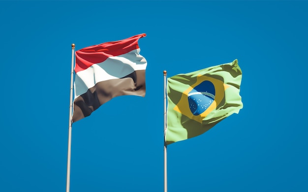 Beautiful national state flags of yemen and brasil together on blue sky