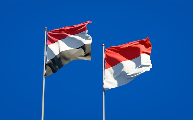 Beautiful national state flags of yemen and indonesia together on blue sky