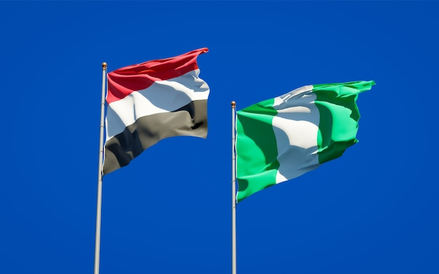 Beautiful national state flags of yemen and nigeria together on blue sky