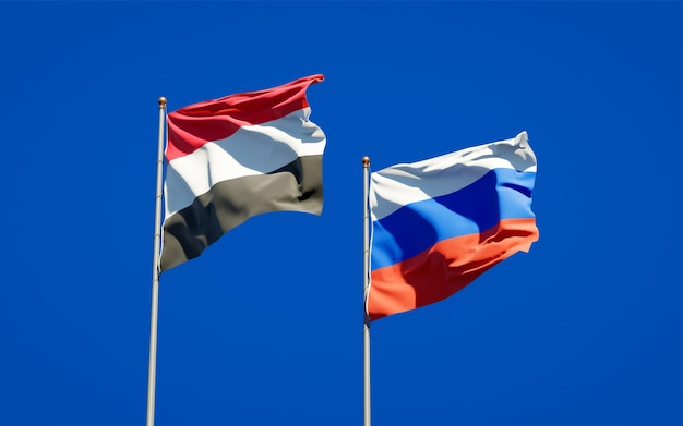 Beautiful national state flags of yemen and russia together on blue sky. 3d artwork