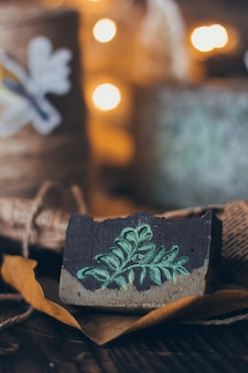 Beautiful natural handcrafted soap on wooden background with botanicals
