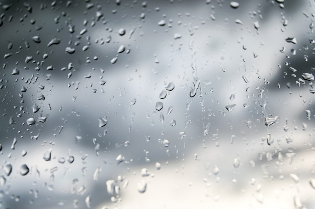 Beautiful nature background by raining and dew drop on the glass.