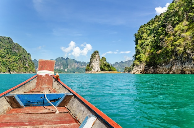 Beautiful nature landscape prow on lake, journey by small boat adventure at ratchapapha dam,travel to asia at khao sok national park, surat thani, thailand