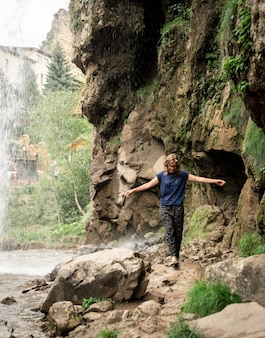 Beautiful nature. small human watching at beautiful mountain waterfall