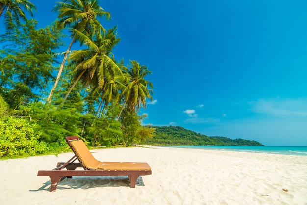 Beautiful nature tropical beach and sea with chair and coconut palm tree on paradise island