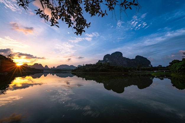 Beautiful nature with sunrise reflection on water ban nong thale, krabi province, thailand