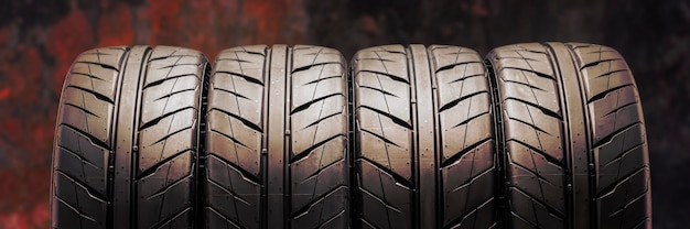 Beautiful new summer tires with a directional sports tread pattern for auto racing and motorsport. reddish fire background.