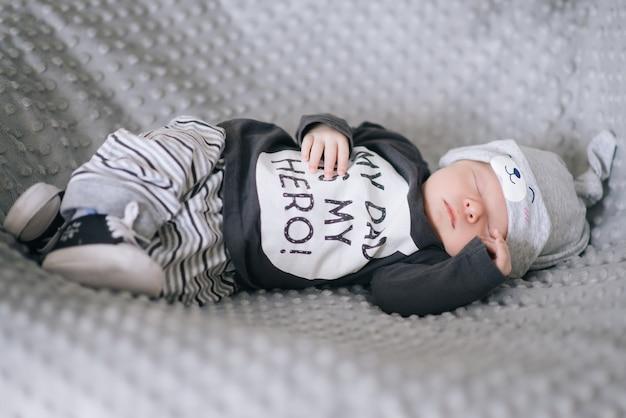 Beautiful newborn baby lying in the crib