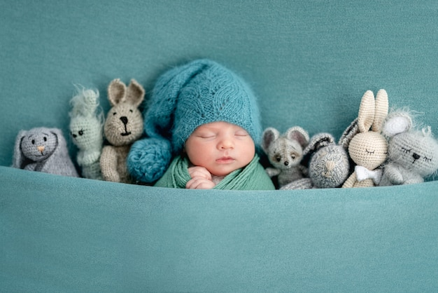 Beautiful newborn with knitted toys