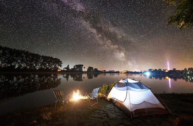 Beautiful night camping under starry sky