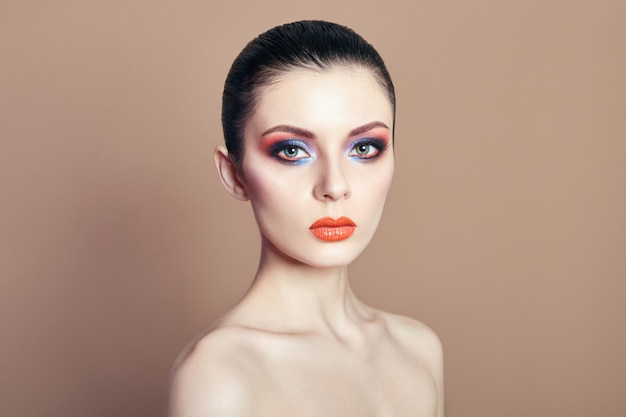 Beautiful nude woman bright contrasting makeup