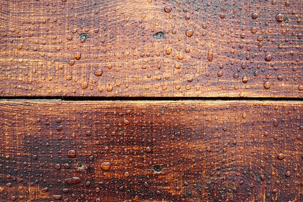 Beautiful old wooden surface covered with raindrops beautiful background top view