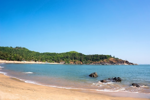 Beautiful om beach with yellow sand - gokarna karnataka india.