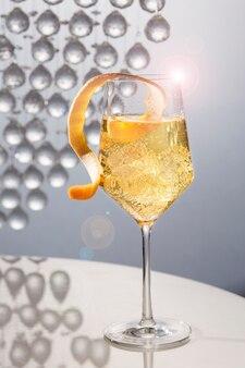 Beautiful orange cocktail on table
