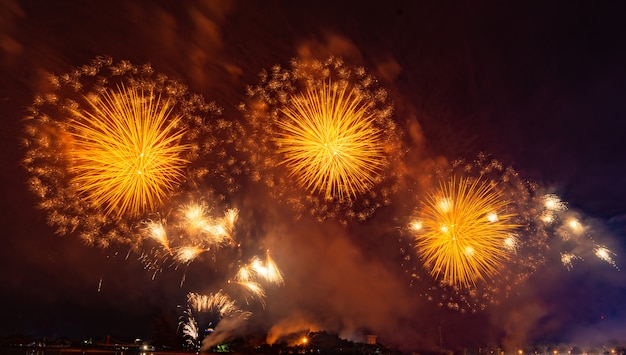 Beautiful orange fireworks display in the urban for celebration on dark