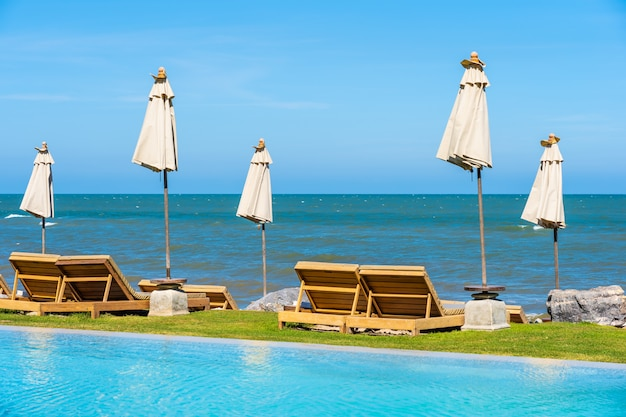 Beautiful outdoor nature landscape with bed deck chair around swimming pool in hotel resort