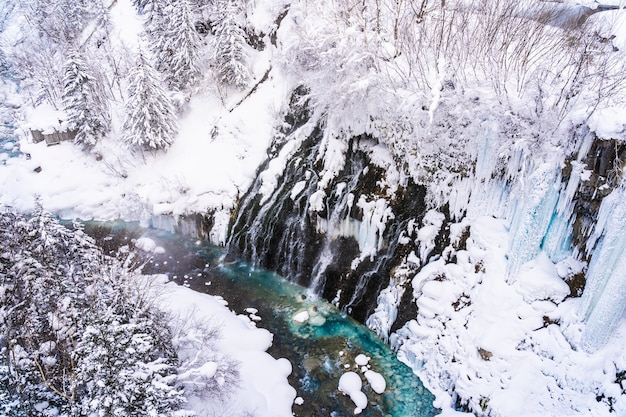 Beautiful outdoor nature landscape with shirahige waterfall and bridge in snow winter season