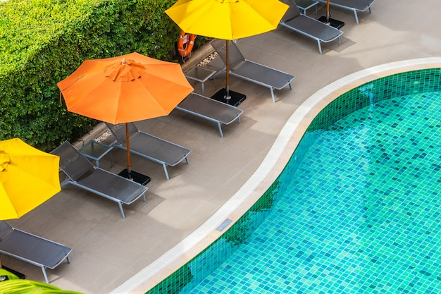 Beautiful outdoor swimming pool in hotel resort for holiday vacation