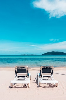 Beautiful outdoor view with umbrella and chair on the beach and sea