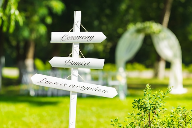 Beautiful outdoor wedding ceremony at the green grass