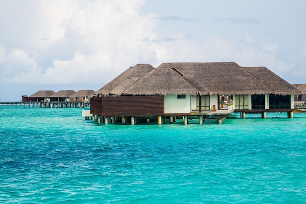 Beautiful overwater bungalows on the ocean in the maldives island