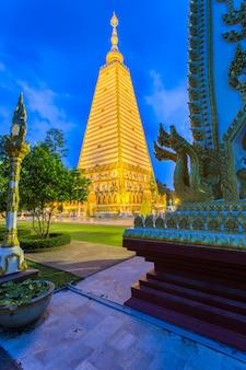 Beautiful pagoda wat phrathat nong bua temple in night time at ubon ratchathani, thailand