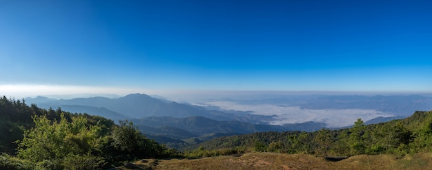 Beautiful panoramic mountain and mist on blue sky background , at north thailand  inthanon national park , chiang mai province , panorama landscape thailand