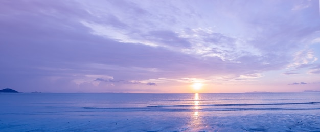 Beautiful panoramic tropical purple blue sea  sunset and yellow clouds background