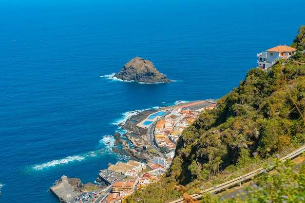 Beautiful panoramic view of a cozy garachico town on the ocean shore from the high mountain
