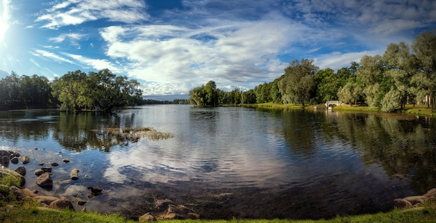 Beautiful panoramic view with sun over the lake and reflections in the water. gatchina. russia.