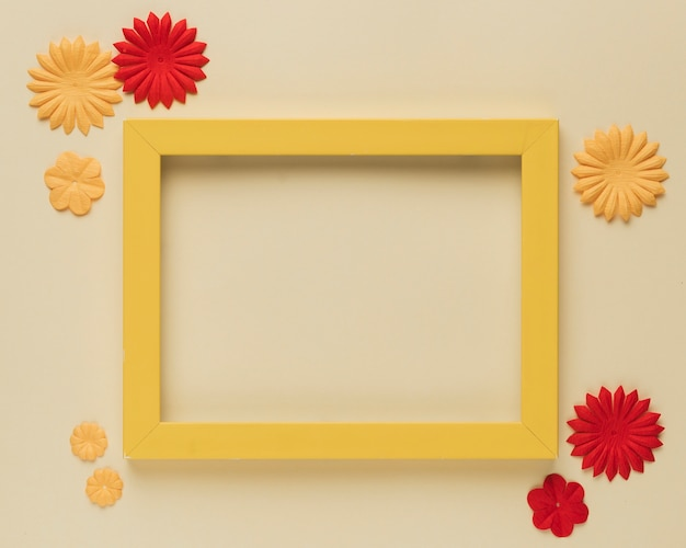 Beautiful paper flower cutout and wooden frame border on beige background