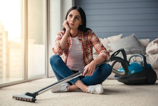 Beautiful pensive young woman is looking away. cleaning concept