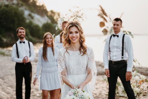 Beautiful people celebrating a wedding on the beach