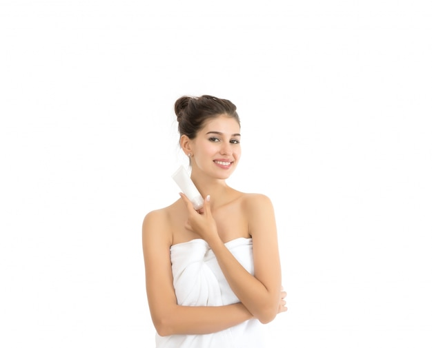 Beautiful perfect woman holding tube with cream for face. beauty concept for your product.