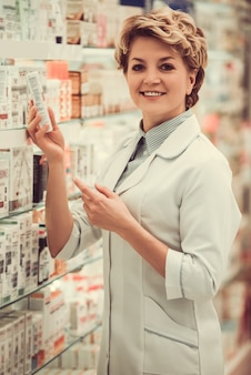 Beautiful pharmacist at work