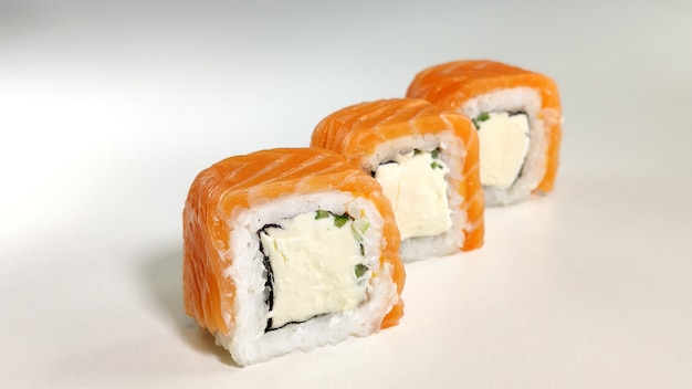 Beautiful philadelphia sushi rolls set with salmon and cream cheese on white background