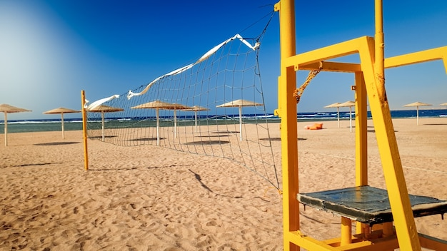 Beautiful photo of beach volleyball field at windy sunny day. active sports on summer holiday vacation