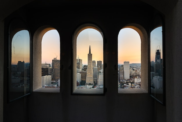 Beautiful photography of downtown san francisco sunset through the window