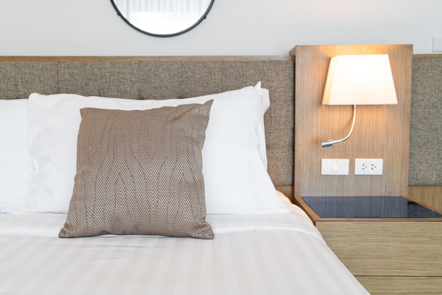 Beautiful pillow on bed decoration room interior