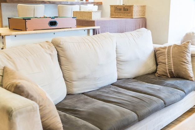 Beautiful pillow on sofa decoration in living room