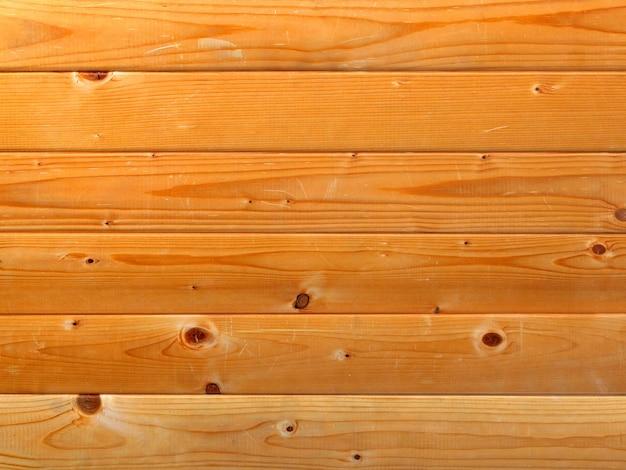 木製の背景に水平に配置された美しい松の板