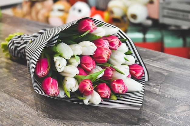 Beautiful pink bouquet of flowers on table.
