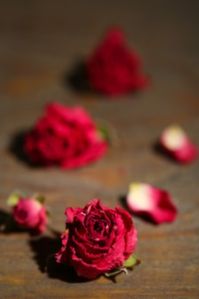 Beautiful pink dried roses on old wooden