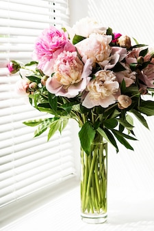 Beautiful pink peony bouquet in a vase. spring mood, romantic present.