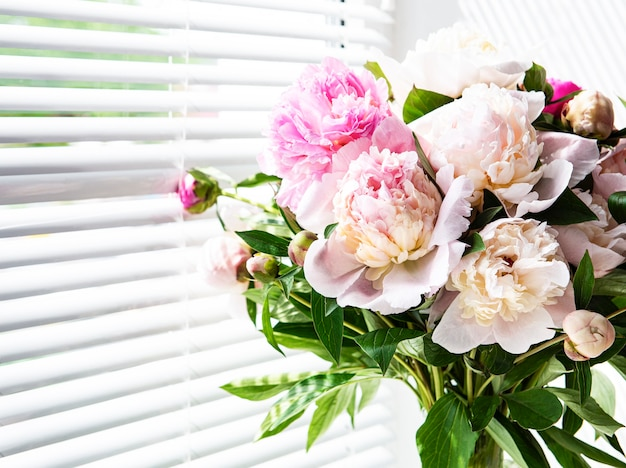Beautiful pink peony bouquet in a vase