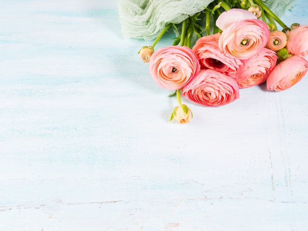 Beautiful pink ranunculus bouquet on turquoise